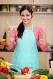 Young woman with kitchen apron Royalty Free Stock Images