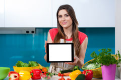 Young woman in the kitchen with copy space tablet Royalty Free Stock Photography