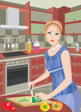 Young woman on kitchen cuts vegetables Royalty Free Stock Images