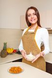 Young woman at kitchen holding plate of oatmeal Royalty Free Stock Photo