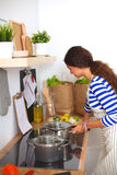 Young woman in the kitchen preparing a food Stock Photo