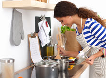 Young woman in the kitchen preparing a food Royalty Free Stock Photo
