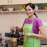 Young woman in kitchen Stock Photo