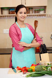 Young woman with kitchen utensil Stock Image