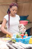 Young woman in the kitchen. This very young woman in the kitchen, takes part in cooking competition organized during this festval fish Royalty Free Stock Photos