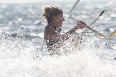 A young woman kite-surfer Royalty Free Stock Photos