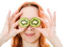 Young woman with kiwi in the hands Stock Photo
