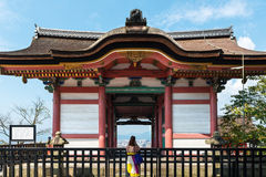 Young woman in Kiyomizu-dera buddist temple in Kyoto Stock Images