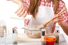 Young woman knead the dough Royalty Free Stock Images