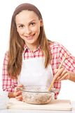 Young woman knead the dough Stock Photo