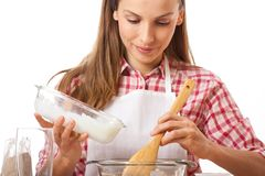 Young woman knead the dough Royalty Free Stock Photos