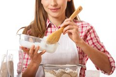 Young woman knead the dough Royalty Free Stock Image