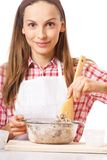 Young woman knead the dough Stock Images