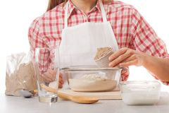 Young woman knead the dough Stock Image