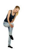 Young woman with knee injury. On white background Royalty Free Stock Photo