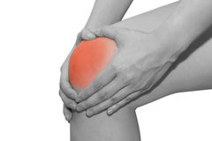 Young woman with knee pain Stock Photo