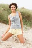 Young Woman Kneeling Amongst Sand Dunes Royalty Free Stock Photo