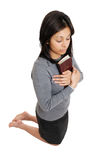 Young woman kneeling with a bible Royalty Free Stock Photo