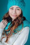 Young woman in knit scarf and hat mint color Stock Photos