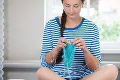 Young woman knits a woolen Stock Photos