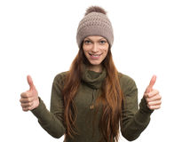 Young woman in knitted cap showing her thumbs up Stock Photos