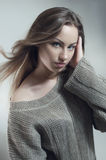 Young woman in knitted  gray sweater. Young woman in knitted gray sweater Royalty Free Stock Photo