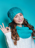 Young woman in a knitted hat showing sign okay hands Stock Image
