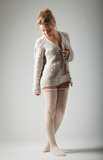 Young woman in knitted jumper on gray background royalty free stock photos