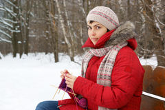 Young woman knitting outdoor Stock Image