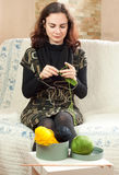Young woman knitting Royalty Free Stock Images