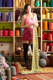Young Woman Knitting Scarf Standing Stock Photos