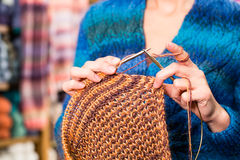 Young woman in knitting shop with circular needle Royalty Free Stock Image