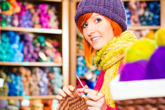 Young woman in knitting shop with circular needle Royalty Free Stock Photos