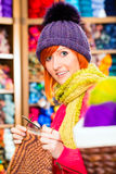 Young woman in knitting shop with circular needle Stock Image