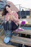 Young woman knitting Stock Photo