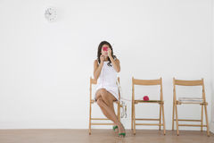 Young Woman Knitting In Waiting Room Royalty Free Stock Image
