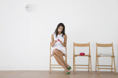 Young Woman Knitting In Waiting Room Royalty Free Stock Images