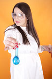 Young woman lab technician holding a test tube Stock Photography
