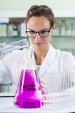 Young woman in laboratory Stock Images