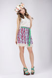 Young Woman in Lacy Skirt and Blouse with Flowers. Pretty Woman in Lacy Skirt and Blouse with Flowers stock image