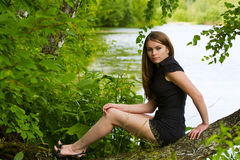 Young woman by the lake. Royalty Free Stock Photo
