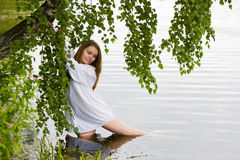 Young woman on the lake. Royalty Free Stock Photography