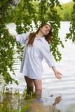 Young woman on the lake. Stock Image