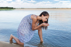 Young woman at lake Royalty Free Stock Photos