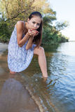 Young woman at lake Royalty Free Stock Photo