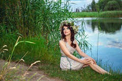 Young woman at the lake Royalty Free Stock Photography