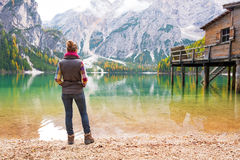 Young woman on lake braies in south tyrol, italy Stock Image