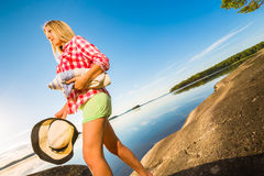Young woman by the lakeside Royalty Free Stock Photography