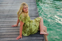 Young woman landing stage on beach on Maldives Stock Photography