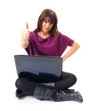 Young woman with laptop. Fashionable young woman with laptop gesturing with thumb up, isolated on white background Stock Photo